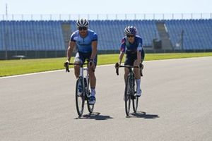 Valtteri Bottas, Mercedes-AMG F1 and Tiffany Cromwell cycle the track