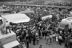 Fans swarm the paddock