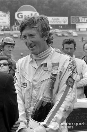 Pole sitter Jochen Rindt celebrates with a bottle of champagne