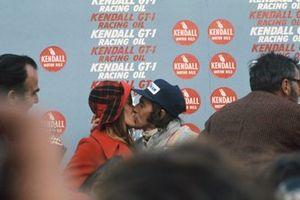Podium: Race winner Jackie Stewart, Tyrrell, kisses his wife Helen