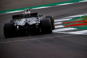 Sparks kick up from the car of Valtteri Bottas, Mercedes F1 W11