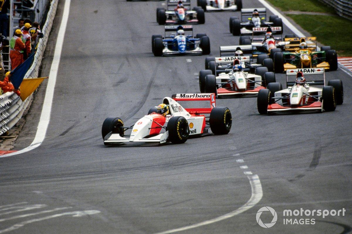 Ayrton Senna, McLaren MP4-8 Ford, leads Aguri Suzuki, Footwork FA14 Mugen-Honda, Derek Warwick, Footwork FA14 Mugen-Honda, and J. J. Lehto, Sauber C12