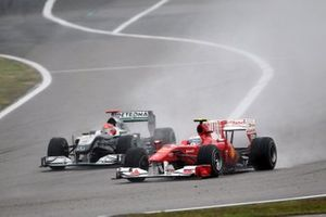 Fernando Alonso, Ferrari F10 and Michael Schumacher, Mercedes GP MGP W01 battle for position