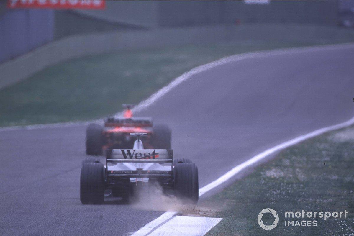Michael Schumacher, Ferrari, leads Mika Hakkinen, McLaren