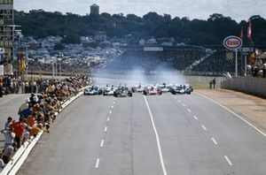 Emerson Fittipaldi, Lotus 72D Ford, Denny Hulme, McLaren M19A Ford, Clay Regazzoni, Ferrari 312B2 and Jackie Stewart, Tyrrell 003 Ford lead at the start