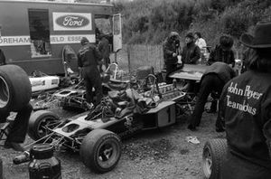 Mechanics work on Emerson Fittipaldi's Lotus 72D Ford in the paddock