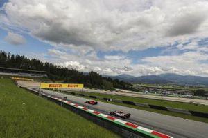 Sebastian Vettel, Ferrari SF1000, leads Antonio Giovinazzi, Alfa Romeo Racing C39