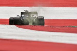 Sparks kick up from the rear of Lewis Hamilton, Mercedes F1 W11 EQ Performance
