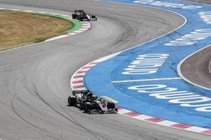 Lewis Hamilton, Mercedes F1 W11 EQ Performance and Kevin Magnussen, Haas VF-20