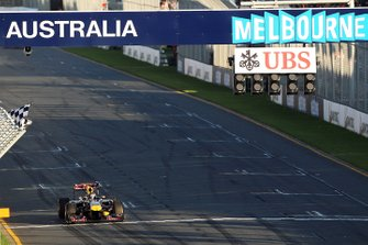 Race winner Sebastian Vettel, Red Bull Racing RB7 takes the chequered flag at the end of the race