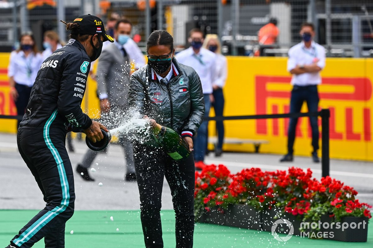 Lewis Hamilton, Mercedes-AMG Petronas F1, sprays champagne on the podium