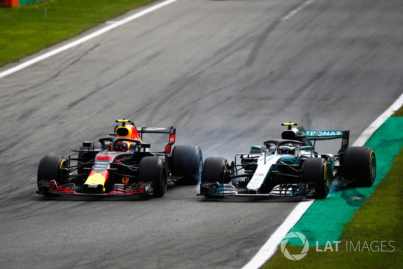 Verstappen is penalised for contact with Bottas