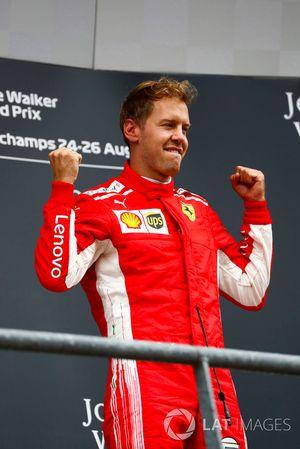 Winner Sebastian Vettel, Ferrari, celebrates on the podium