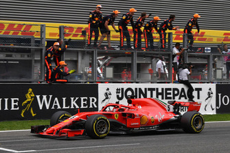 Race winner Sebastian Vettel, Ferrari SF71H crosses the line