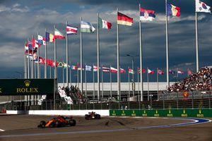 Stoffel Vandoorne, McLaren MCL33, leads Max Verstappen, Red Bull Racing RB14