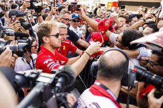 Sebastian Vettel, Ferrari, signs an autograph