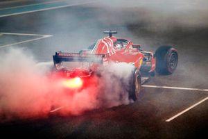 Sebastian Vettel, Ferrari SF71H, esegue dei donut sulla griglia di partenza, alla fine della gara