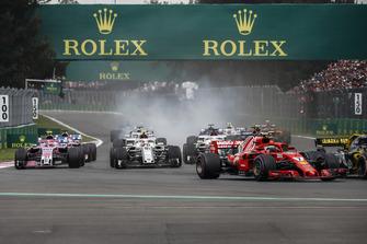 Kimi Raikkonen, Ferrari SF71H, Charles Leclerc, Sauber C37 and Esteban Ocon, Racing Point Force India VJM11 battle