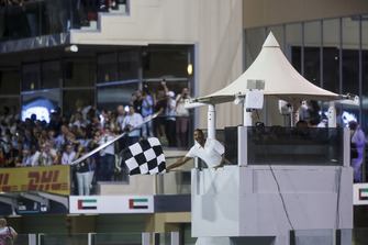 Will Smith waves the chequered flag at the end of the race