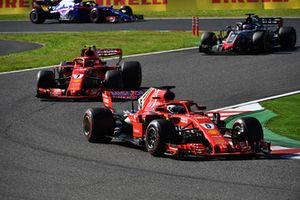 Sebastian Vettel, Ferrari SF71H leads Kimi Raikkonen, Ferrari SF71H and Romain Grosjean, Haas F1 Team VF-18