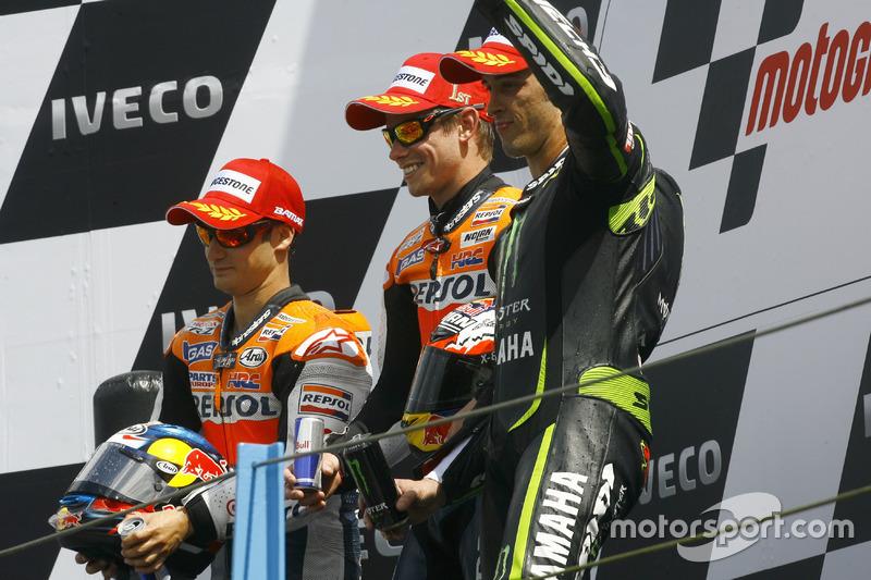 Podio: 1º Casey Stoner, 2º Dani Pedrosa, 3º Andrea Dovizioso
