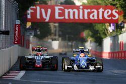 (L to R): Esteban Gutierrez, Haas F1 Team VF-16 and Felipe Nasr, Sauber C35 battle for position