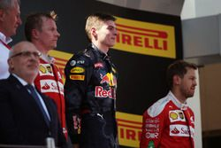 The podium, Ferrari, second; Max Verstappen, Red Bull Racing, race winner; Sebastian Vettel, Ferrari