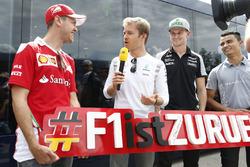 Sebastian Vettel, Ferrari; Nico Rosberg, Mercedes AMG F1; Nico Hulkenberg, Sahara Force India F1; et Pascal Wehrlein, Manor Racing, font la promotion du retour du GP d'Allemagne