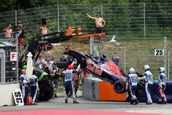 The damaged Scuderia Toro Rosso STR11 of Daniil Kvyat, is craned away after he crashed during qualif
