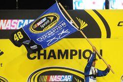 A Hendrick Motorsports crew member celebrates in Victory Lane