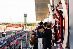Third place Daniel Ricciardo, Red Bull Racing, lifts his trophy