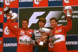 Podium: Race winner Heinz-Harald Frentzen, Williams FW19 Renault, second place Michael Schumacher, Ferrari, third place Eddie Irvine, Ferrari