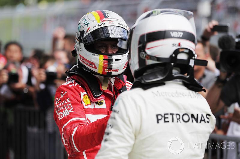 Sebastian Vettel, Ferrari, congratulates winner Valtteri Bottas, Mercedes AMG F1, in parc ferme