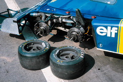 The front two wheels of the Tyrrell P34 Ford in the paddock
