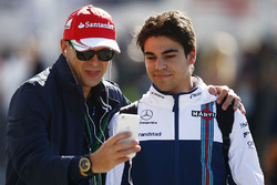 Lance Stroll, Williams, takes a picture with a fan