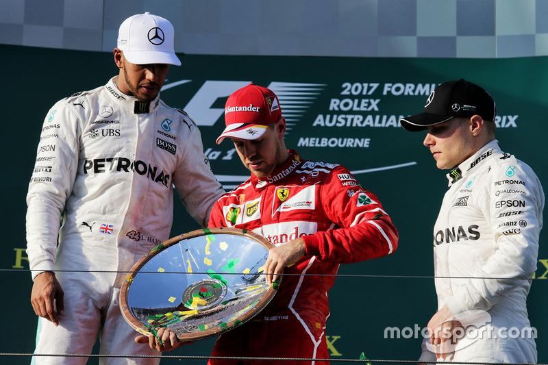 Podio: il vincitore della gara Sebastian Vettel, Ferrari, il secondo classificato Lewis Hamilton, Mercedes AMG F1, il terzo classificato Valtteri Bottas, Mercedes AMG F1