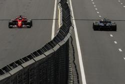 Sebastian Vettel, Ferrari SF70H and Kevin Magnussen, Haas F1 Team VF-17