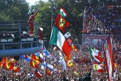 Third place Sebastian Vettel, Ferrari, shows his trophy to the crowd