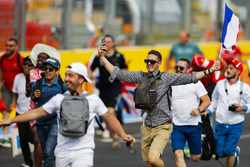 Fans invade the circuit and head towards the podium celebrations