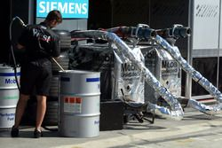 A McLaren mechanic prepares Mobil fuel in the pits