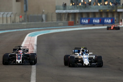 Romain Grosjean, Haas F1 Team VF-17 goes wide trying to overtake Lance Stroll, Williams FW40