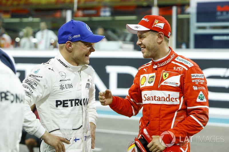 Il primo qualificato Valtteri Bottas, Mercedes AMG F1 e il terzo qualificato Sebastian Vettel, Ferrari
