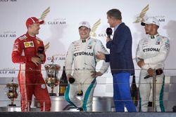 David Coulthard, Channel 4 F1, interviews Valtteri Bottas, Mercedes AMG F1, 2nd position, Sebastian Vettel, Ferrari, 1st position, and Lewis Hamilton, Mercedes AMG F1, 3rd position, on the podium