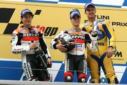 Podium: Tweede plaats Nicky Hayden, Repsol Honda Team, Racewinnaar Dani Pedrosa, Repsol Honda Team, derde plaats Colin Edwards