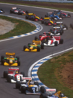 Damon Hill leads Alain Prost, both Williams FW15C Renault's, Ayrton Senna, McLaren MP4/8 Ford, Michael Schumacher, Riccardo Patrese, both Benetton B193B Ford's, Michael Andretti, McLaren MP4/8 Ford, and Jean Alesi, Ferrari F93A, at the start