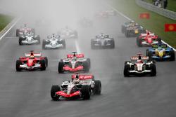 Kimi Raikkonen, McLaren Mercedes MP4/21 leads at the start of the race