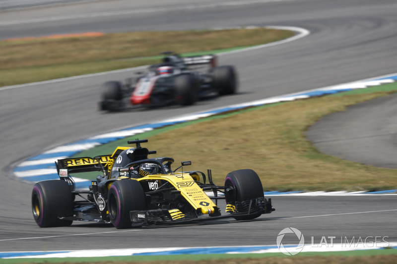 Hulkenberg passes two battling cars in one go