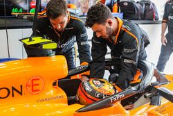 Engineers help Stoffel Vandoorne, McLaren MCL33, strap in to his seat