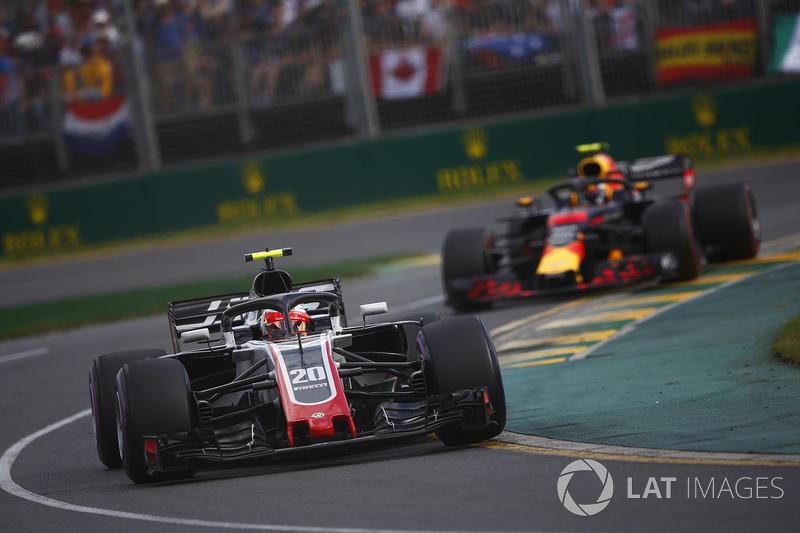 Kevin Magnussen, Haas F1 Team VF-18 Ferrari, leads Max Verstappen, Red Bull Racing RB14 Tag Heuer