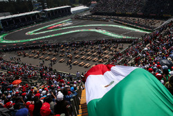 Sergio Perez, Sahara Force India VJM10 passes Mexican flag in the grandstand